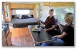 Airflow Caravans: Interior showing TV and kitchen top