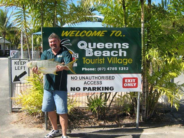 Craig Bowen holding a trophy at Queens Beach Tourist Village